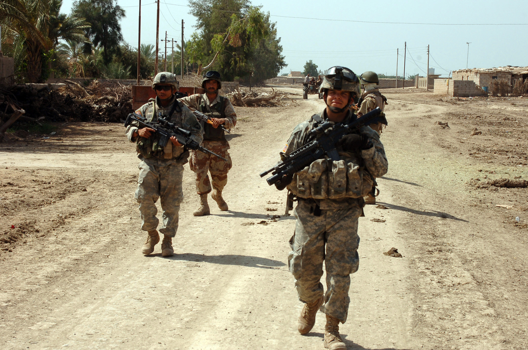 Members of B Company, 1-502nd Infantry Battalion, 101st Airborne Division conduct a patrol during Operation Desert Scorpion. The operation is an effort to disrupt terrorist activities near Rushdie Mula, Iraq. The photo was taken on the afternoon of April 20, 2006 as part of Operation Iraqi Freedom. (U.S. Army photo by Sgt. 1st Class David D. Isakson) (Released)
