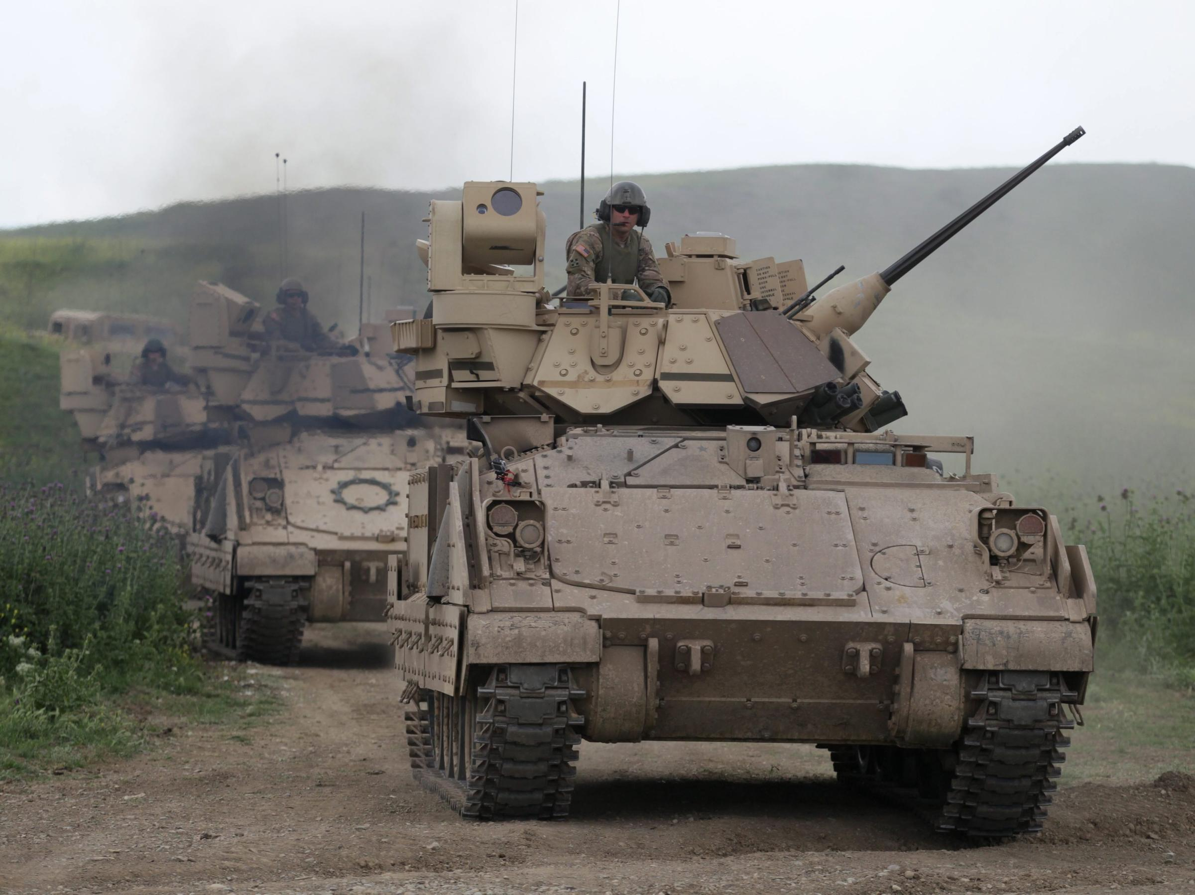 U.S. Bradley fighting vehicles take part in a joint exercise with Georgia at a military base near Tbilisi. Bradleys would be deployed to NATO member states in Eastern Europe and the Baltics if a Pentagon proposal is approved.