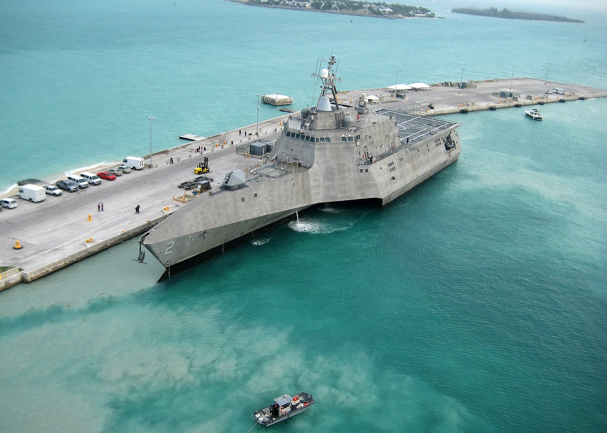 "100329-N-1481K-298 KEY WEST, Fla. (March 29, 2010) The Navy's newest littoral combat ship USS Independence (LCS 2) arrives at Mole Pier at Naval Air Station Key West. Independence is on the way to Norfolk, Va., for commencement of initial testing and evaluation of the aluminum vessel before sailing to its homeport in San Diego. Independence is a fast, agile, mission-focused ship specifically designed to defeat ""anti-access"" threats in shallow, coastal water regions, including surface craft, diesel submarines and mines. (U.S. Navy photo by Naval Air Crewman 2nd Class Nicholas Kontodiakos/Released)"
