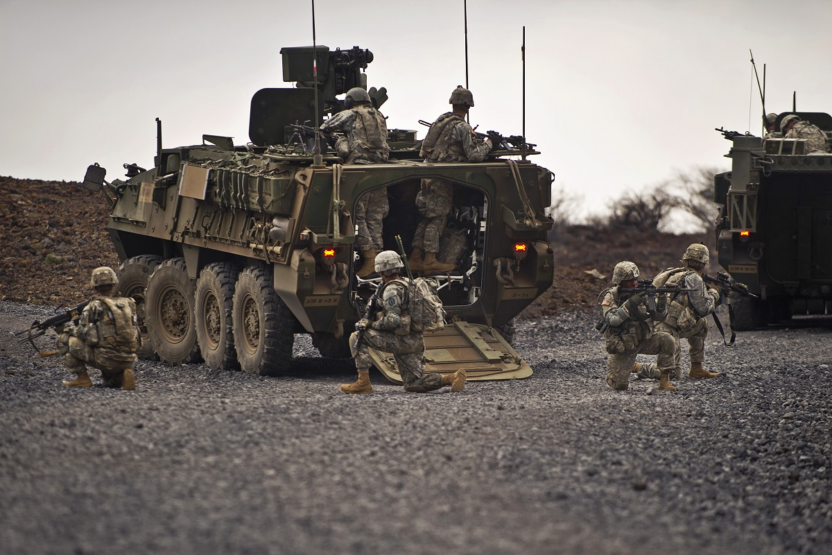 "U.S. Army soldiers from Charlie Company, 1st Battalion, 21st Infantry Regiment, 2nd Stryker Brigade Combat Team, 25th Infantry Division, ""Gimlets"" pull security after dismounting from a M1126 Infantry Carrier Vehicles, (ICV) Sept. 20, 2012, during a live fire exercise at the Pohakuloa Training Area, on Hawaii's Big Island. Soldiers from the 1st Battalion, 21st Infantry Regiment, are conducting a month-long exercise which is focused on platoon level collective training with enabler integration. The training will culminate in a combined arms live fire exercise later this month."