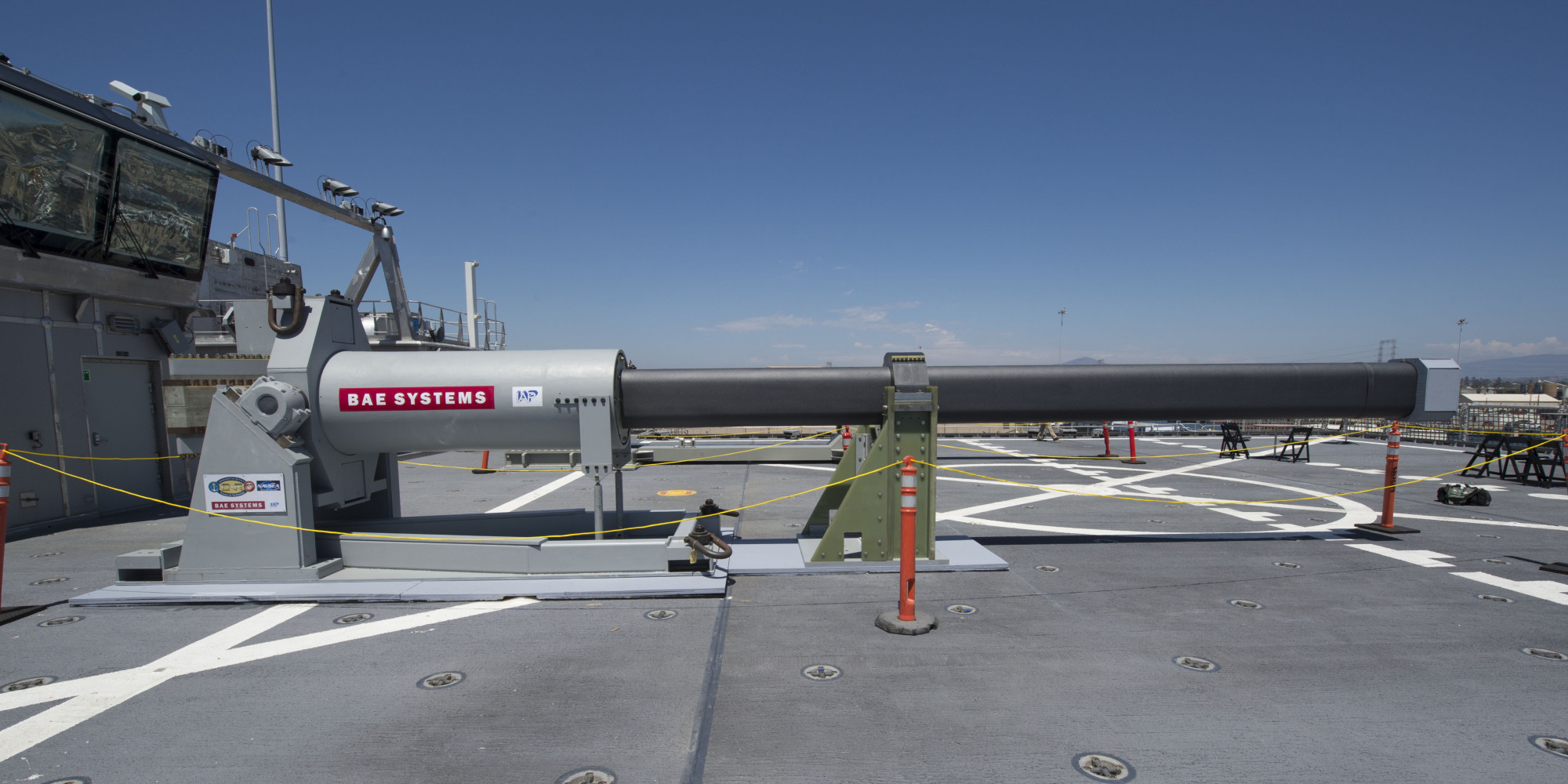 140708-N-ZK869-010 SAN DIEGO (July 8, 2014) One of the two electromagnetic railgun prototypes on display aboard the joint high speed vessel USS Millinocket (JHSV 3) in port at Naval Base San Diego. The railguns are being displayed in San Diego as part of the Electromagnetic Launch Symposium, which brought together representatives from the U.S. and allied navies, industry and academia to discuss directed energy technologies. (U.S. Navy photo by Mass Communication Specialist 2nd Class Kristopher Kirsop/Released)
