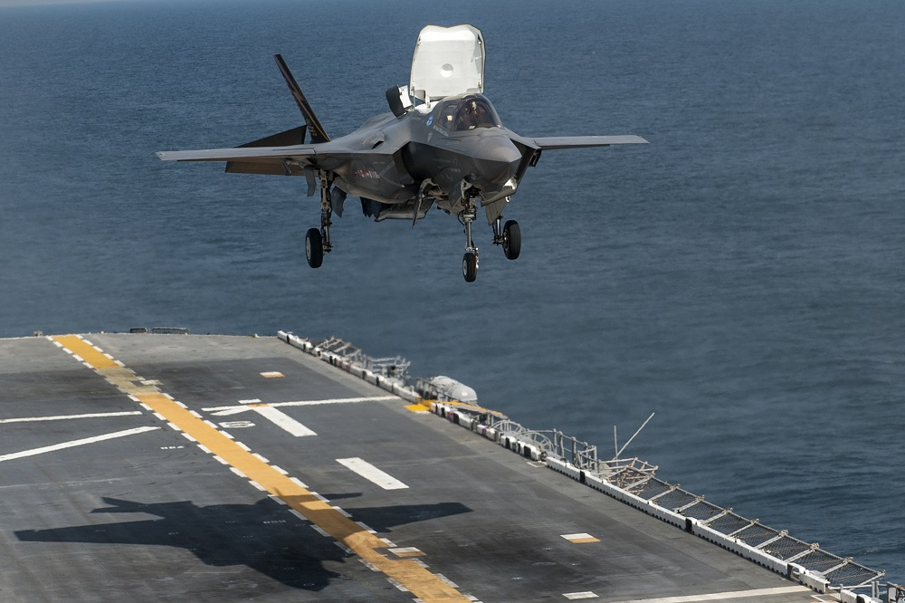 130814-O-ZZ999-038 ATLANTIC OCEAN (Aug. 14, 2013) An F-35B Lightning II aircraft takes off from the amphibious assault ship USS Wasp (LHD 1) during the second at-sea F-35 developmental test event. The F-35B is the Marine Corps variant of the Joint Strike Fighter and is undergoing testing aboard Wasp. (U.S. Navy photo courtesy of Lockheed Martin by Todd R. McQueen/Released)/Released)