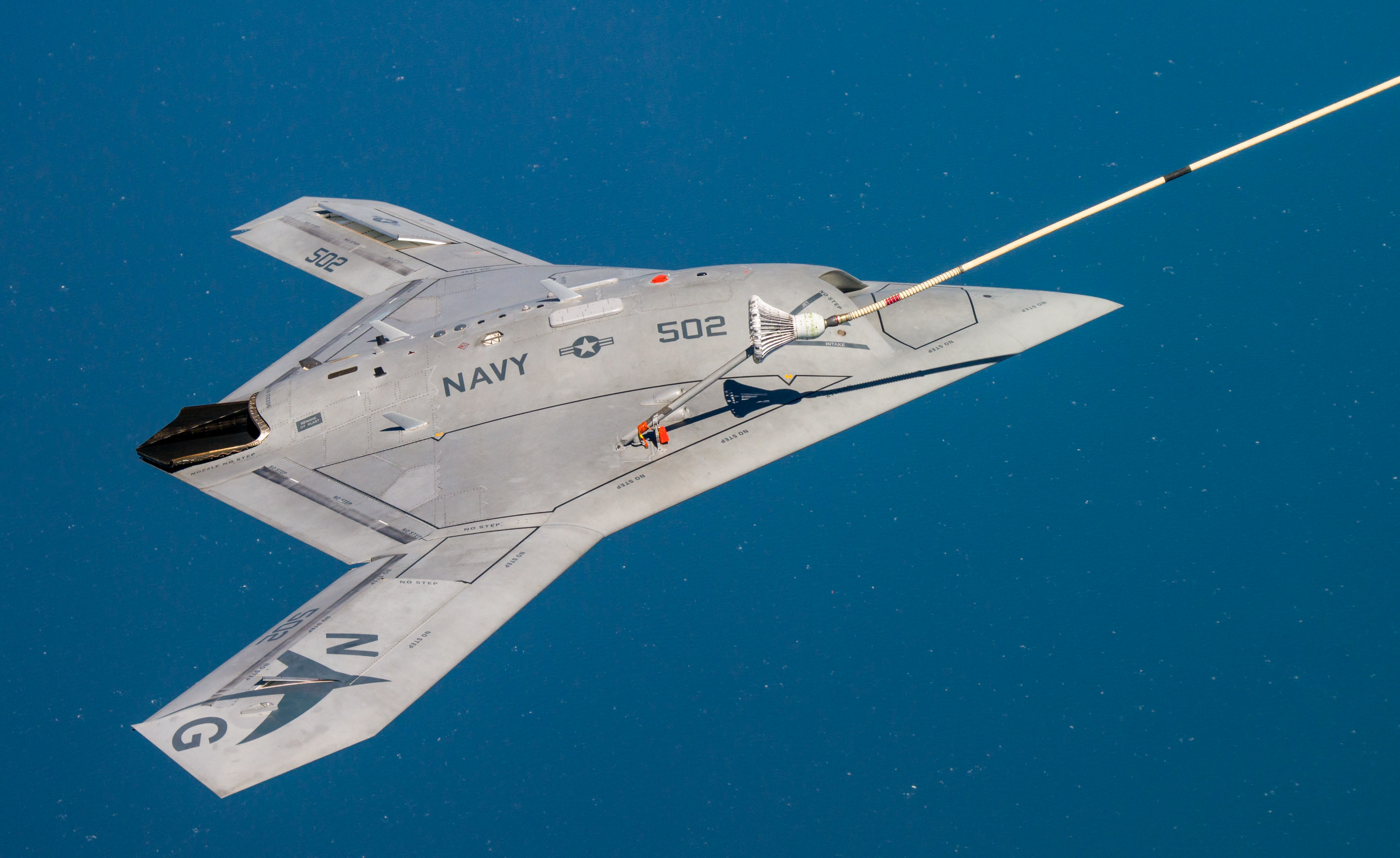 150422-N-CE233-377 PATUXENT RIVER, Md. (April 22, 2015) The Navy's unmanned X-47B receives fuel from an Omega K-707 tanker while operating in the Atlantic Test Ranges over the Chesapeake Bay. This test marked the first time an unmanned aircraft refueled in flight. (U.S. Navy photo/Released)