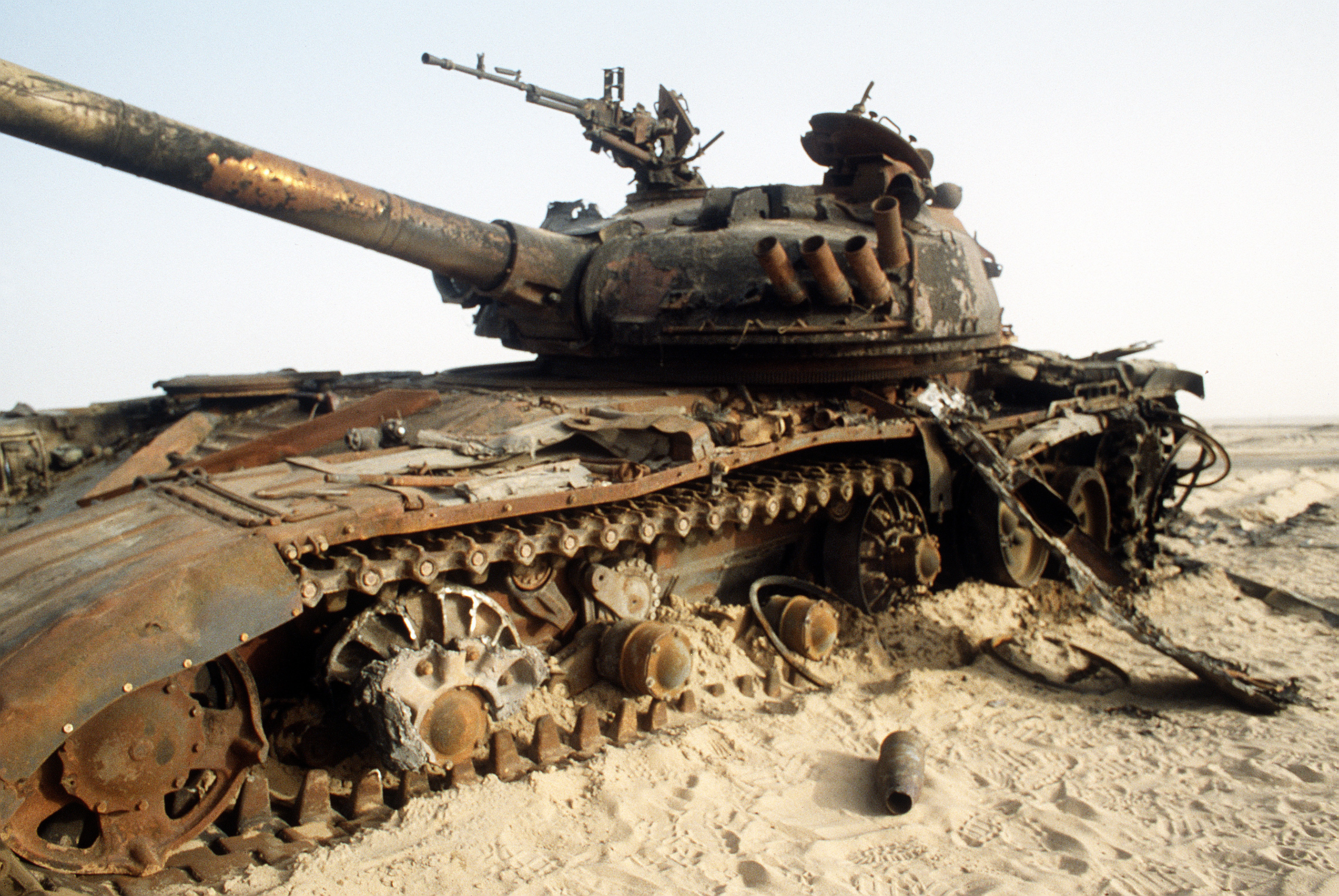 A destroyed Iraqi T-72 main battle tank sits in the desert in the wake of advancing coalition forces during Operation Desert Storm.