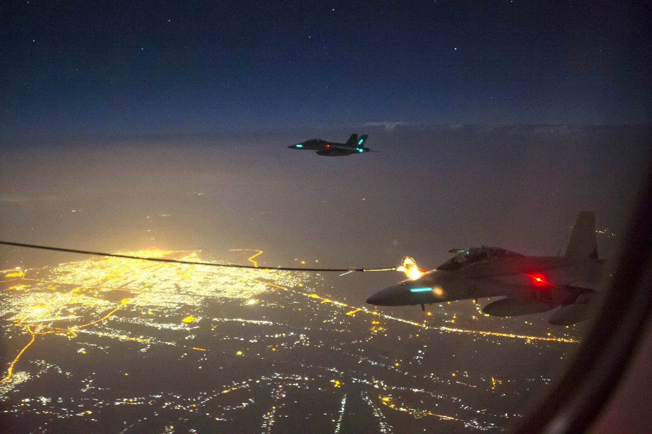 "A handout photo taken October 5, 2014 and obtained on October 9 shows two Royal Australian Air Force (RAAF) F/A-18F Super Hornet aircraft refuelling from a RAAF KC-30A Multi Role Tanker Transport aircraft above a city in Iraq. A Super Hornet fighter jet has carried out Australia's first bombing raid in Iraq, targeting what the defence ministry on October 9, 2014, described as a ""facility"" of the Islamist State group. AFP PHOTO/HO/AUSTRALIAN DEFENCE/SERGEANT HAMISH PATERSON ----EDITORS NOTE ----RESTRICTED TO EDITORIAL USE MANDATORY CREDIT "" AFP PHOTO / AUSTRALIAN DEFENCE/SERGEANT HAMISH PATERSON"" NO MARKETING NO ADVERTISING CAMPAIGNS - DISTRIBUTED AS A SERVICE TO CLIENTS"